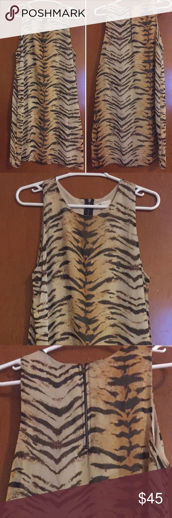 Animal print mini dress. EVERLY animal print mini dress.  Never worn. Everly Dresses Mini