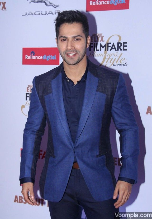 Bollywood's young hunk Varun Dhawan shows off his style in a blue suit. via Voompla.com
