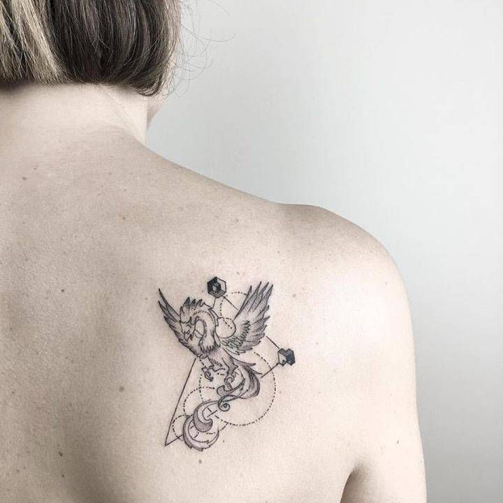 Phoenix tattoo on the right shoulder blade.