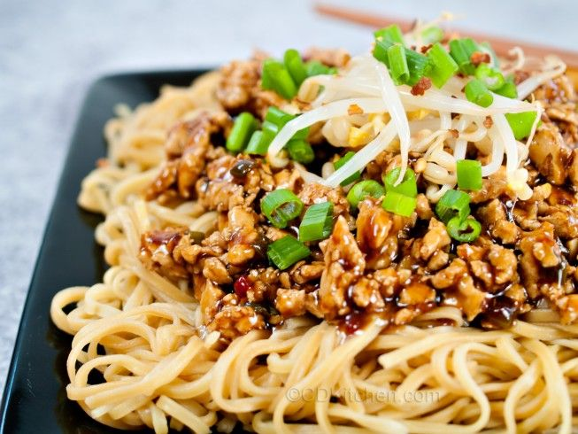 Copycat P.F. Chang's Dan Dan Noodles - CDKitchen.com -  Ground chicken is simmered in a spicy sauce and served over Asian egg noodles, just like at P.F. Chang's