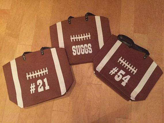 This item is for a canvas printed football bag. The football print is on both sides of the bag. This will be a great addition to your football gear. Add your name, monogram, teams name or number to the bag. Bag Measurements: 22X17X18 ALL BAGS ARE PRESSED USING A HIGH HEAT PRESS Please include to seller: 1. What you want on bag. If it is a monogram please put in order that you want it to appear (First, Last, Middle) 2. Color of Vinyl IF NO COLOR OF MONOGRAM OR NAME IS CHOSEN IT WILL BE UP ...