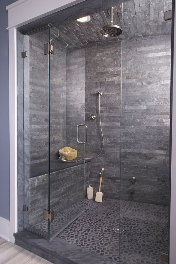 Wow!love this dark stone shower cave!! Pebble flooring and splitface tiles can be sourced from Mandarin Stone.