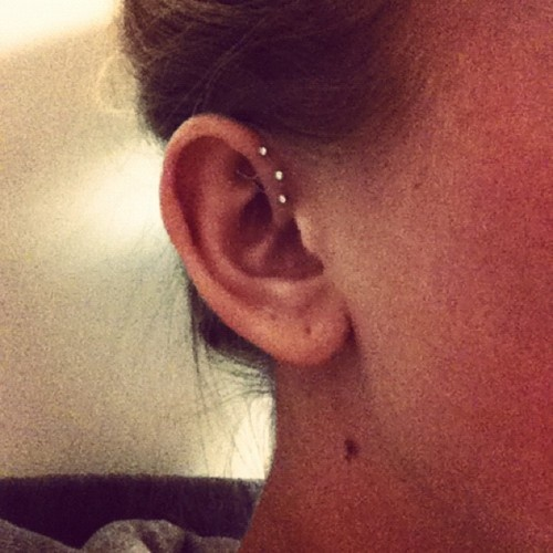 not a tat. but still awesome.  triple helix piercing