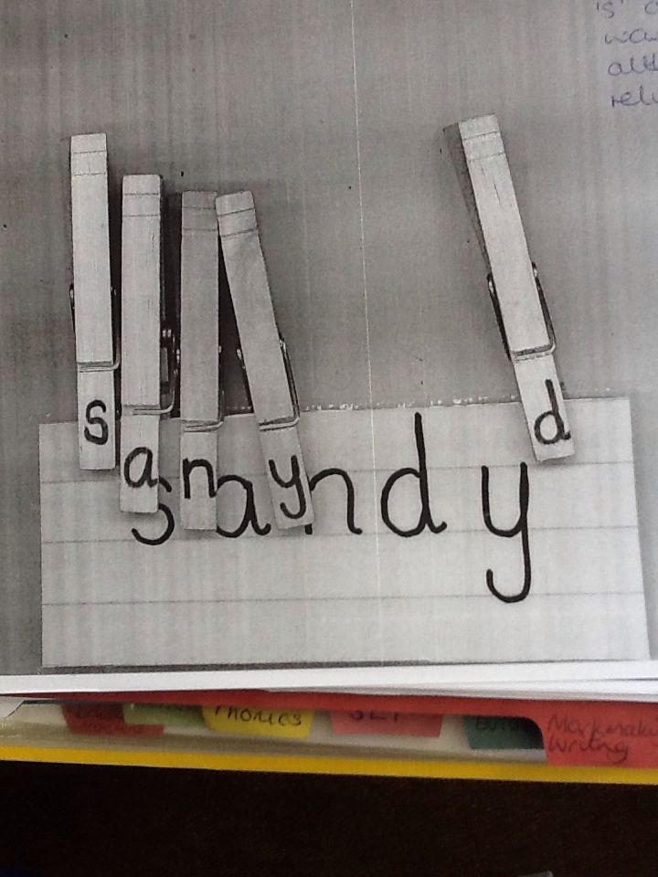 Matching pegs with letters on to letters in name. Pupil has attempted to match letters independently.