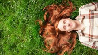 Woman with ginger hair & cancer