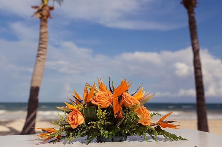 Cancun Destination Wedding at Secrets Maroma Beach, MX  Beautiful beach themed orange flowers!   Quetzal Wedding Photo