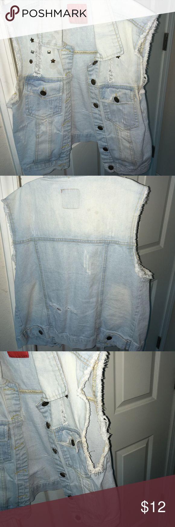 Short sleeve jean Jacket •White/Light blue Short Sleeve Jean Jacket. •Ripped designs on front and back. •Ripped designs on sleeve. •Size Small Jackets & Coats Jean Jackets