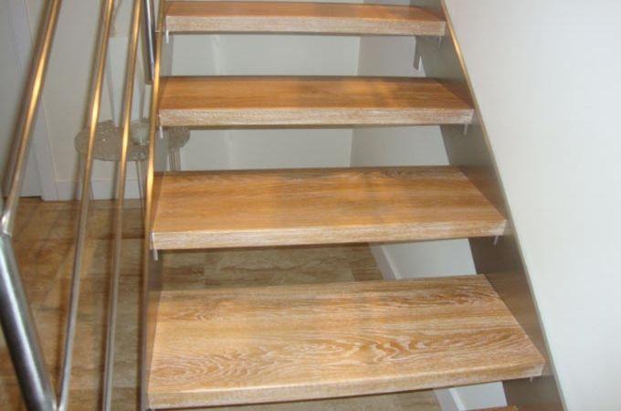 Zancas acero inox y pelda os madera servitja - Como forrar una escalera de madera ...