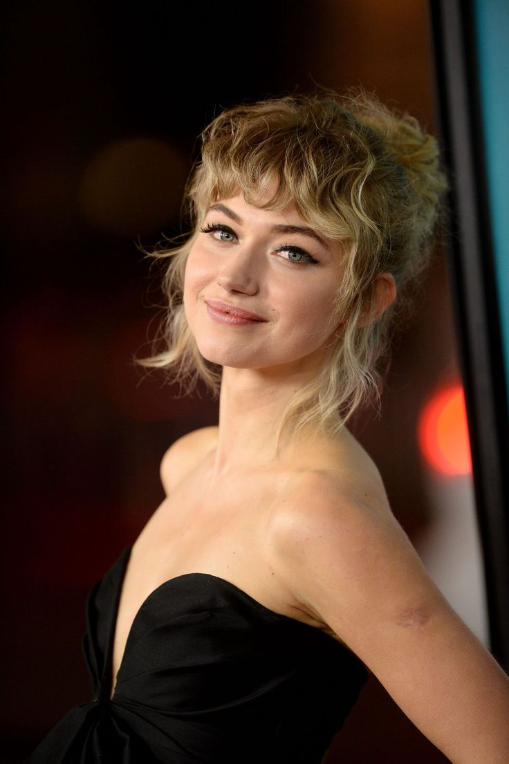 Imogen Poots walks the red carpet with curly bangs and a plunging neckline
