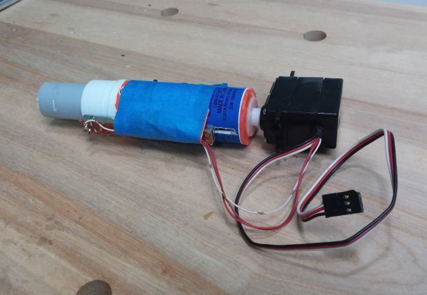 Build a linear actuator from a glue stick, a servo, and a slide potentiometer.