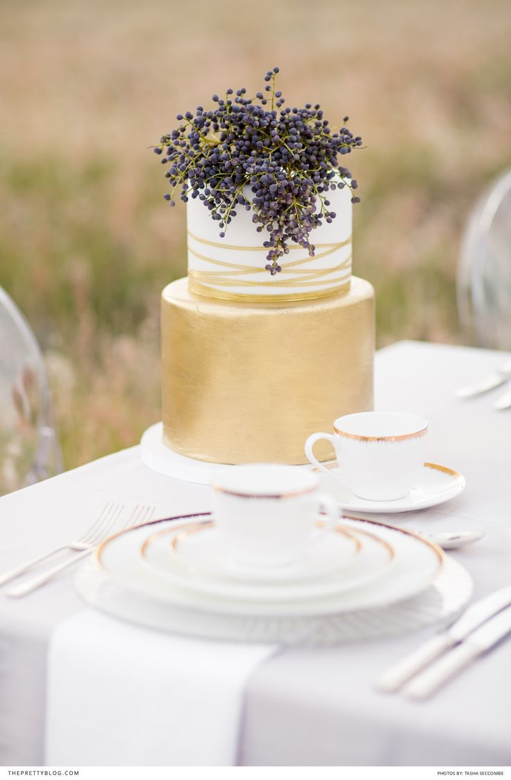 Metallic wedding cake base with floral topper | Cake: Edible art cakes