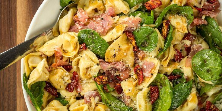 Tuscan Tortellini Salad​ This hearty pasta salad might be better than a trip to Tuscany.