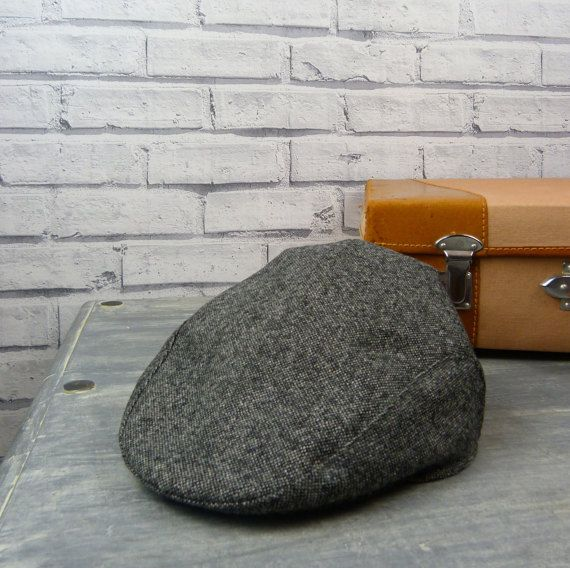 Fab mens flat cap hat handmade from this fantastic modern Yorkshire wool tweed fabric. This fabric is fantastic quality. Fully lined with an Irish linen fabric. Bang on trend this season. Whippet dog recommended but not essential.  made to order in the following sizes  small, will fit up to 21.5 medium - will fit headsize up to 22.5 large, will fit up to 23.5 x large, will fit up to 24.5 xx large, will fit up to 25.5   please allow up to 7 days for made to order  If you are unsure of your…