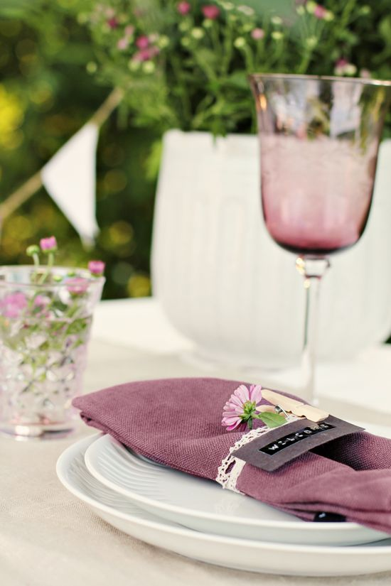 I love this purple table setting because of the color and flowers. I would use this for a special occasion like a formal dinner. I think this would cost about 50-100 to make.