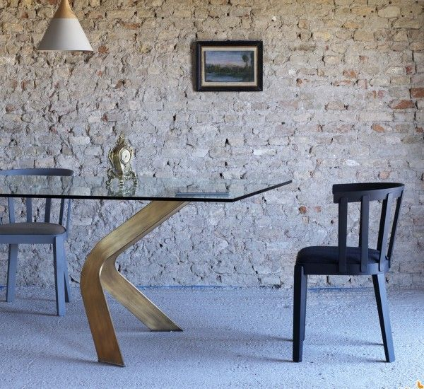 """The table Bipede is an original idea of Miniforms Lab for Miniforms.  The table Bipede has an exceptional base formed by legs placed at important """"Parenthesis"""" that open to hold the ethereal clear glass top."""