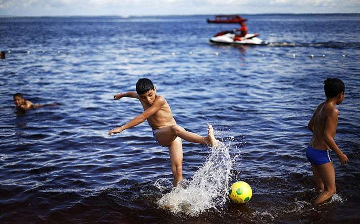 Brazilian kids plays soccer at the Ponta Negra beach on the Rio Negro in Manaus