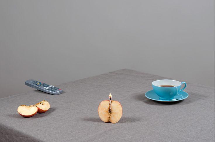 Apple with candle by Csilla Klenyánszki