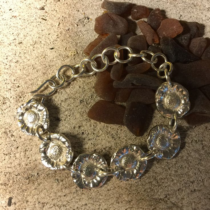Fine Silver daisies with Sterling Silver chain bracelet.