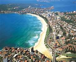 Manly, Australia - easy, worthwhile day trip from Circular Quay via ferry. Gorgeous beach, a nice walk/jog path around the harbor, lots of shops & restaurants