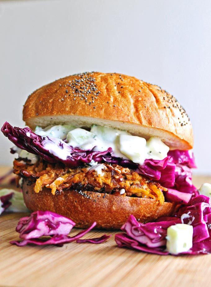 Unique and tasty homemade veggie burgers! Carrot tahini quinoa burgers with tzatziki are topped with freshly made tzatziki and a nutty cabbage slaw.