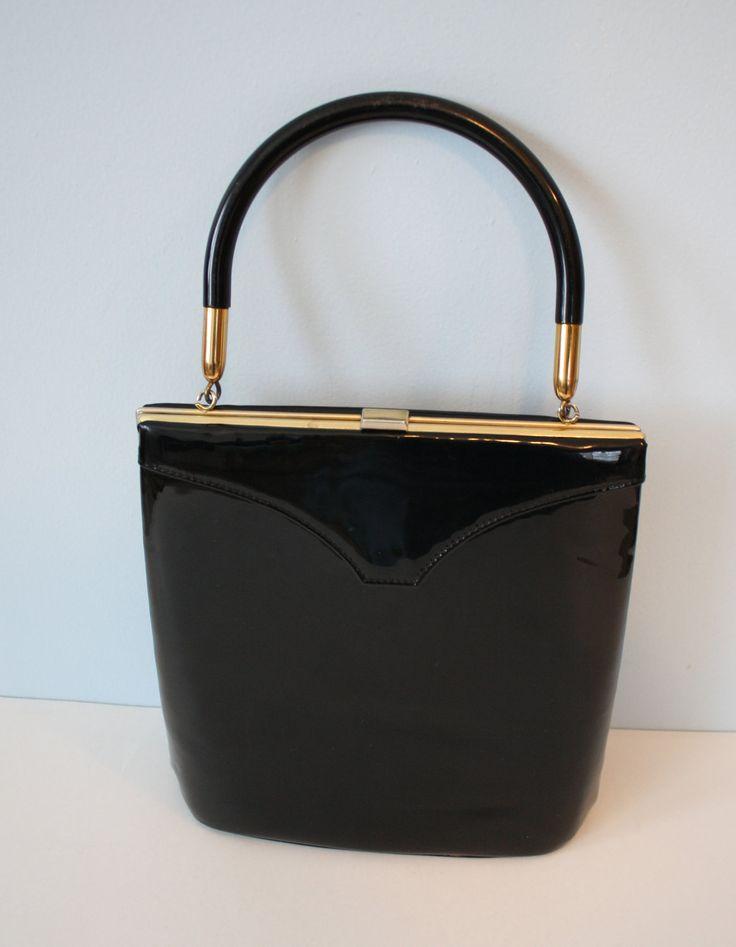 1950s Black Patent Handbag / Vintage Retro 50s Tall Box Purse by FoxyBritVintage on Etsy https://www.etsy.com/listing/118002441/1950s-black-patent-handbag-vintage-retro