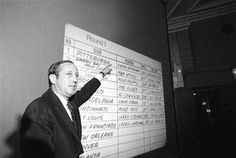 Former NFL commissioner Pete Rozelle points at the 1970 NFL Draft board. Phil Olsen of Utah State was selected by Boston at No. 4, behind Terry Bradshaw, who was the Steelers' No. 1 pick.