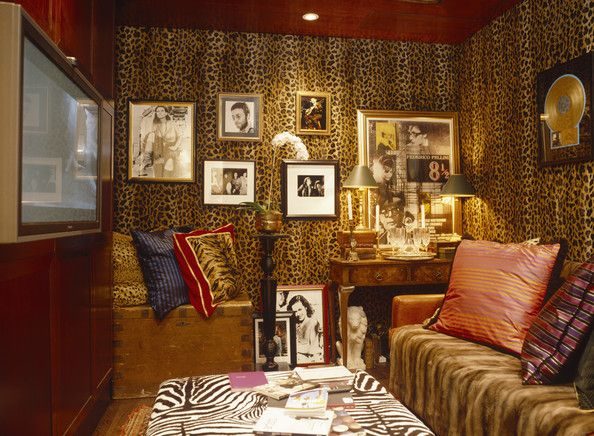 Yellow Eclectic Living Room Framed artworks displayed on leopard-print walls in an eclectic living room.