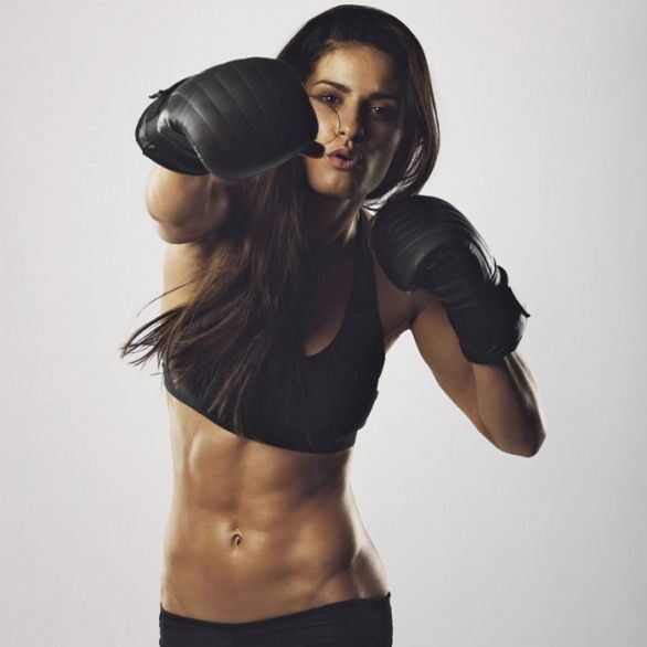 Fit girl who knows how to defend herself! Learn self-defence next to doing fitness. How to cause pain and put someone down, to deter and get away.