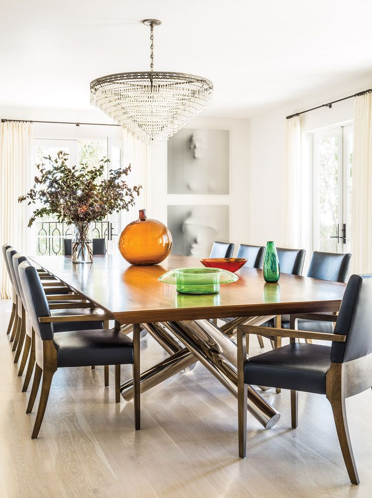 A Minotti Dining Table With Joseph Jeup Chairs In Rich Blue Edelman Leather Sits Beneath Murano Chandelier Attributed To Cenedese Perez Uses Her Maiden