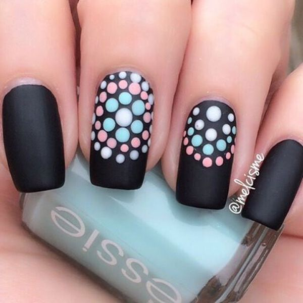 Black nail polish have always been fun to work with, so add some personality to your matte black nails by adding dots in lighter colors.