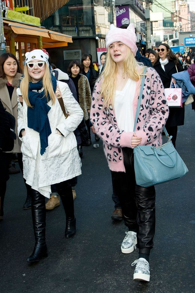 The sisters took on Seoul, South Korea wearing matching but not-matching hats. Guess they are both into cats.
