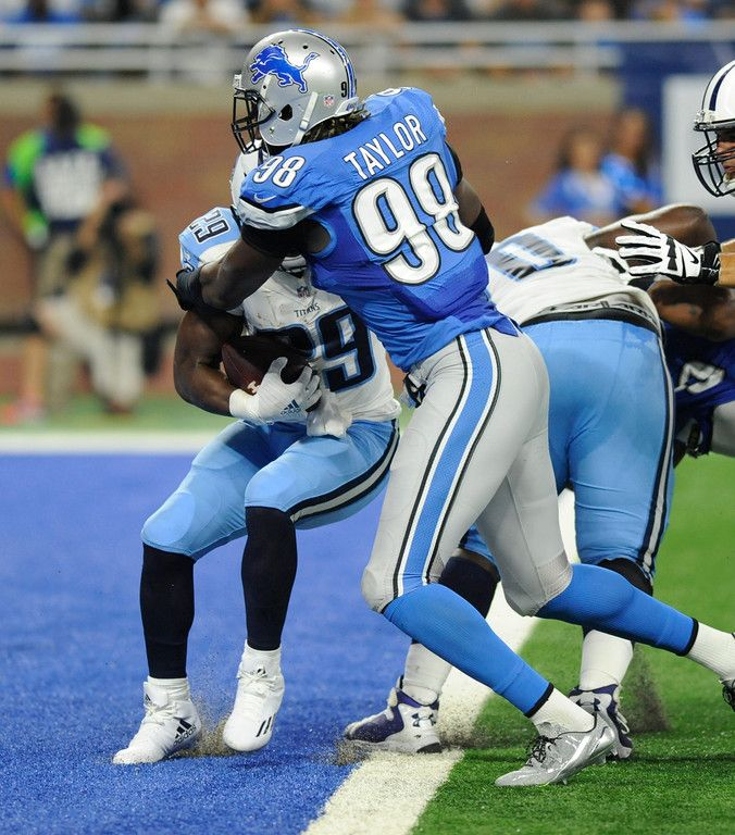 Tennessee Titans running back DeMarco Murray is tackled in the end zone by Detroit Lions defensive end Devin Taylor (98) for a touch back during the first half of an NFL football game, Sunday, Sept. 18, 2016, in Detroit. (AP Photo/Jose Juarez)