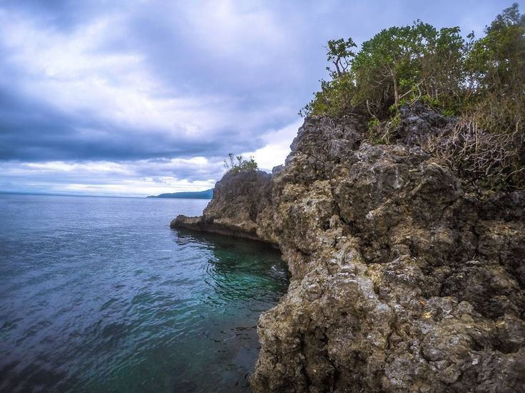 Ready to jump! Molopolo is perfect for snorkeling and cliff jumping! #cliff #cliffjumping #nature #travelleyte #travelphotography #photography #leyte #liloansouthernleyte #molopolo