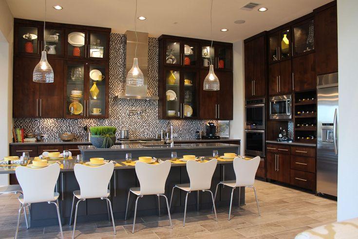 Contemporary kitchen cabinets with dark walnut, slab veneer cabinet doors by TaylorCraft Cabinet Door Company