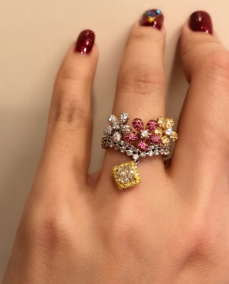 Fancy yellow diamond , white diamond and pink sapphire ring