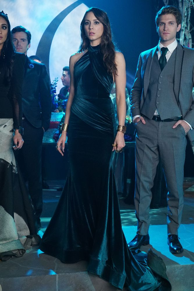 Spencer went for a stunning floor-length green gown for prom.  The high neck and long train is classic Spencer.   - Seventeen.com
