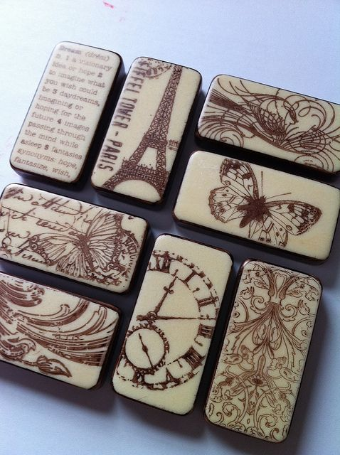 They are VERY easy to make. They are the backs of plain dominos. I then use rubber stamps (a couple of these are from Tim Holtz) and stamped the images in Stayz On permanent ink brown. Then I rubbed the sides in the same brown color ink to finish them. I haven't decided if they will become magnets or if I should frame it as a set.