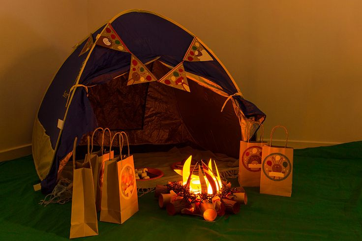 Find all the ideas you need for an awesome indoor camping party including how to make a fake bonfire, camping food ideas, games, printables and more!