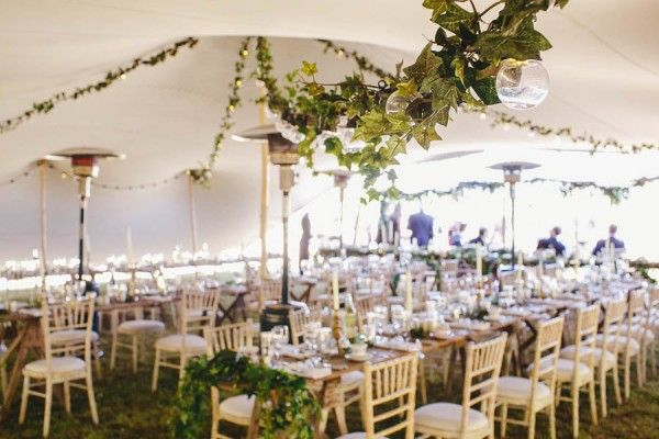 Love the greenery draped throughout the tent | Gather and Tides Photography
