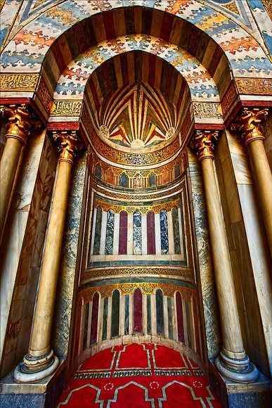 The Mihrab of the Sultan Hassan Mosque in Cairo, Egypt. A mihrab is a niche in the wall of a mosque that indicates the direction of the Kaaba in Mecca and hence the direction that Muslims should face when praying. Beautiful architecture!
