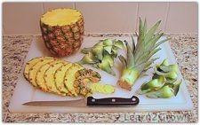 Ananas : Couper l'ananas sur le plateau...