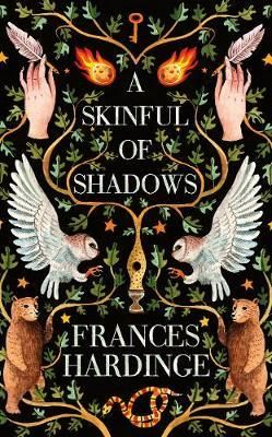 A Skinful of Shadows by Frances Harding: beautifully designed with a hidden cover under the dust jacket. This dark historical otherworldly tale is about a girl who can be possessed by the spirits of the dead.