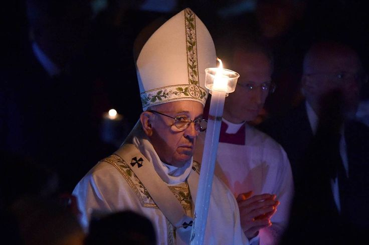 Pope Francis was wrapping up a bleak week in Europe by presiding over a solemn vigil service and ushering in Easter  with a message of hope.