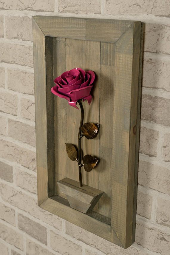 This vintage-meets-modern art designed to enrinch your home or office decoration with metal rose and wooden frame combination that created elegant 3D visual. The  decorative rose remain fresh and beautiful for years. Made with love by Mr Alain Lampron from #AlainsBlacksmithShop on Etsy, this artificial flower will add warmth & comfort to your space. Perfect gift for yourself and everybody. #wallhanging #rusticflower #valentinesgift #housewarming #mothersdaygift #weddinggift #metalrose…
