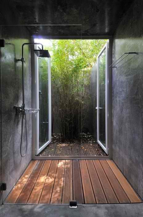 Concrete shower with wood floor