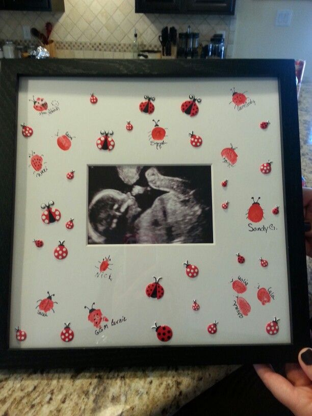 ladybug themed baby shower have everyone do a finger print design their own bug