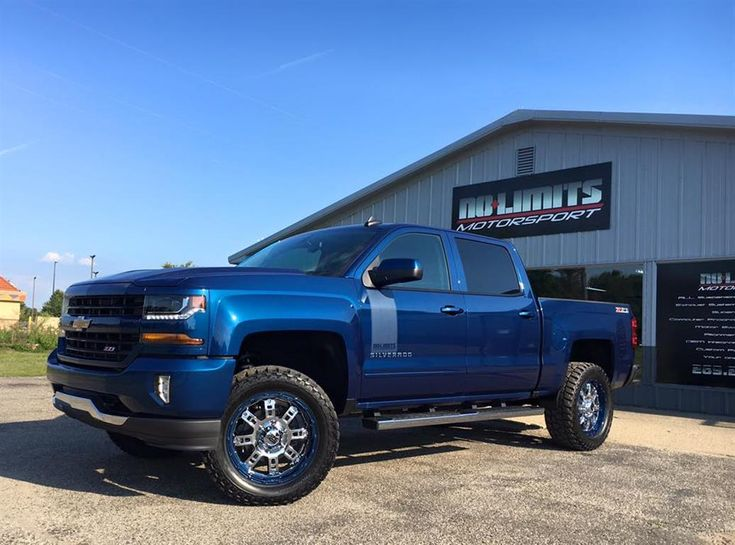 2016 Chevy Silverado With Rough Country Suspension XD Wheels Color Matched Lip Mickey Thompson ATZ Tires And No Limits Badging