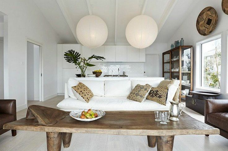 White living room with circular lights. Houzz.