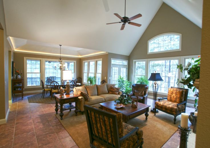 Great room from plan 825-D, The MacLachlan. The generous #Great #Room enjoys a dramatic #Cathedral ceiling, a rear wall of windows, access to two rear decks, a fireplace, and built-in bookshelves. View more photos of this plan at http://www.flickr.com/search/?w=24192252@N05&q=The%20MacLachlan.