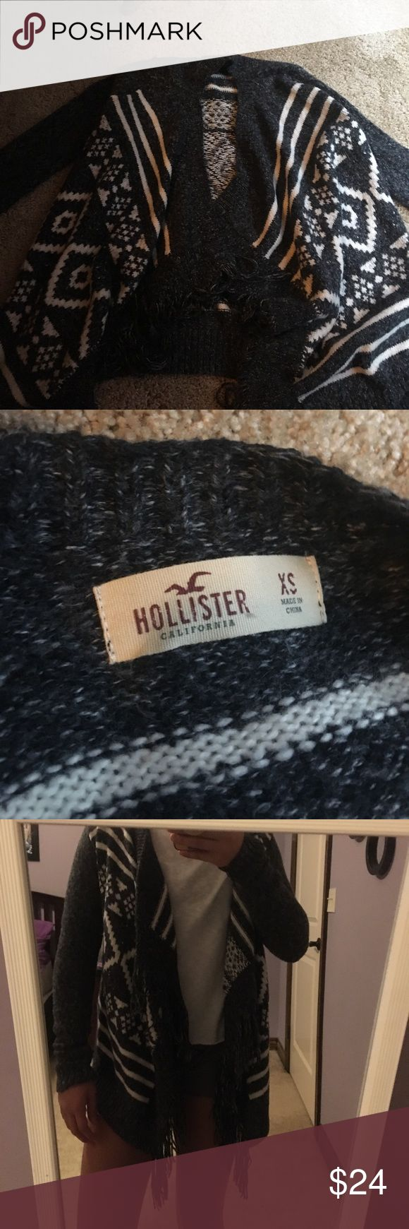 grey and white sweater A very soft cute sweater! Fits very well, size XS in women's. In the back it gets shorter to about waist line, in the front it goes down to about mid thigh. :) Hollister Sweaters Cardigans
